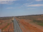 Train tracks cutting through the red arid NSW desert